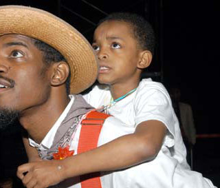 ATLANTA - JUNE 11:  Recording artist, Andre 3000 Benjamin (L), and his son, Seven Benjamin, attend the VIBE Music Festival at the Georgia Dome on June 11, 2005 in Atlanta, Georgia.  (Photo by Ray Tamarra/Getty Images)