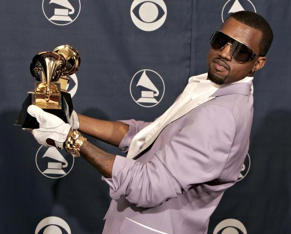 LOS ANGELES, CA - FEBRUARY 08: Singer Kanye West with his awards for Best Rap Song, Best Rap Solo Performance and Best Rap Album in the press room at the 48th Annual Grammy Awards at the Staples Center on February 8, 2006 in Los Angeles, California. (Photo by Kevin Winter/Getty Images)
