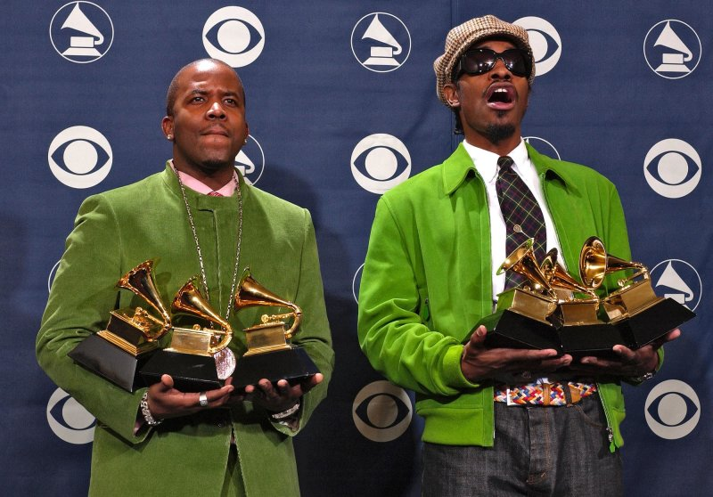 OutKast members Big Boi, left, and Andre 3000 pose with the three awards they won at the 46th Annual Grammy Awards, Sunday, Feb. 8, 2004, in Los Angeles. The duo is reuniting for Lollapalooza. Reed Saxon/AP