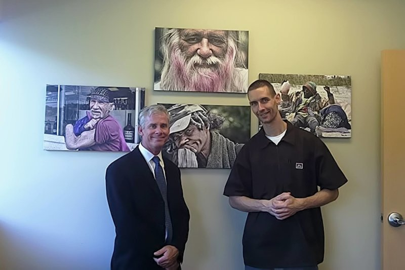 Arpad Lovas and the Director of Nursing at Jacksonville University Dr. Fry. This picture was taken in Dr.Fry's office, the pictures on the wall are photos taken by Arpad.